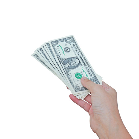 Dollars in hand on white background  photo