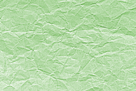 green tone: Old crumpled paper in green tone for background. Stock Photo
