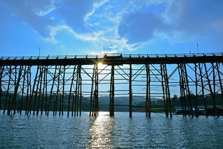 floating bridge: The silhouette of Old wooden bridgeMon Bridge in Sangkhlaburi District, Kanchanaburi, Thailand.