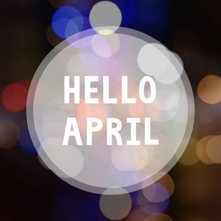 Hello April lettering on bokeh background.