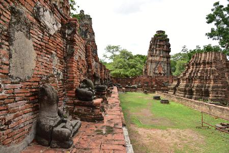 relics: Damaged Buddha statues at Wat Mahathat Temple of the great relics, Ayutthaya, Thailand. Stock Photo