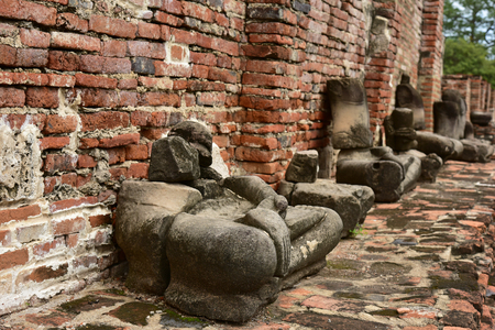 relics: Damaged Buddha statues at Wat Mahathat Temple of the great relics, Ayutthaya, Thailand. Stock Photo