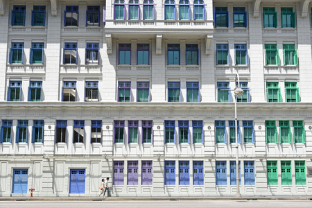 SINGAPORE - JANUARY 04: MICA building on January 04, 2015 in Singapore. It was known as the Old Hill Street Police Station. This building has a total of 927 windows and are painted in the rainbow color.