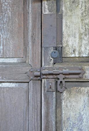 door bolt: Close up of old door bolt on wooden background
