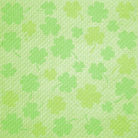 saint patrick   s day: Shamrock on green Tissue for Happy Saint Patrick s day. Stock Photo