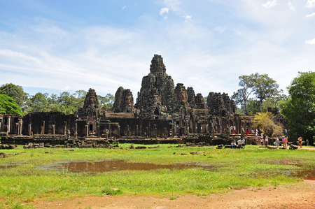 SIEM REAP, CAMBODIA - AUGUST 10: Tourists visit Bayon Temple on August 10, 2014 in Siem Reap, Cambodia. The Bayon is a well-known and richly decorated Khmer temple at Angkor Thom in Cambodia.