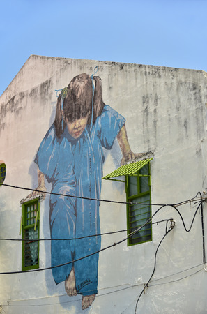 wall mural: GEORGETOWN PENANG, MALAYSIA - JULY 30, 2015: Little Girl in Blue Painted wall mural by artist Ernest Zacharevic in George Town, Penang, Malaysia. Editorial