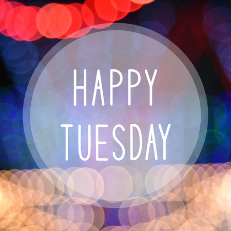 tuesday: Happy Tuesday on colorful bokeh background.