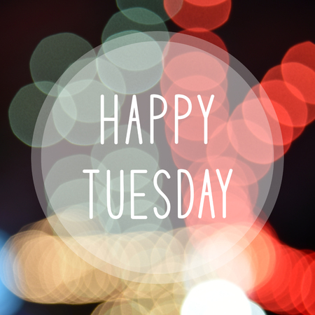 Happy Tuesday on colorful bokeh background.