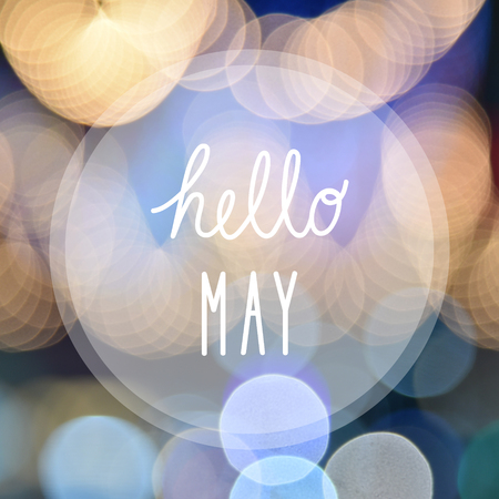 Hello May greeting on bokeh lights in night background. Stock Photo