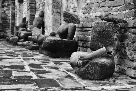 relics: Damaged Buddha statues at Wat Mahathat (Temple of the great relics), Ayutthaya, Thailand. Black and white. Stock Photo