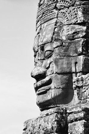 Faces of Bayon temple in Angkor Thom, Siem Reap, Cambodia. Black and white. Stock Photo