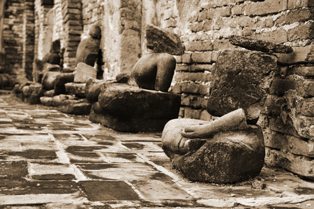relics: Damaged Buddha statues at Wat Mahathat (Temple of the great relics), Ayutthaya, Thailand. Sepia toned. Stock Photo