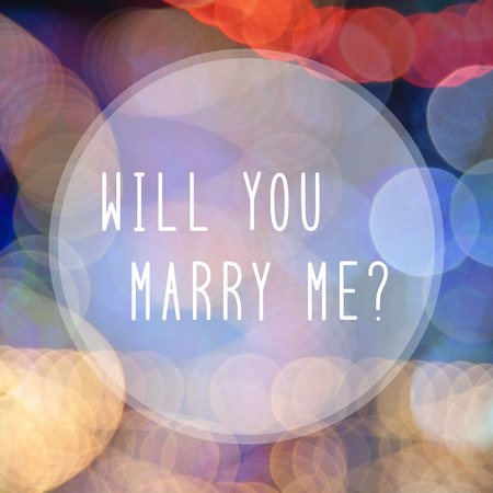 will you marry me: Will you marry me text in bokeh lights ibackground.