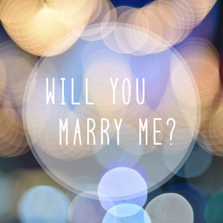 will you marry me: Will you marry me text in bokeh lights background.