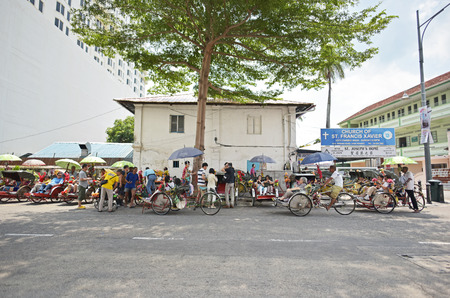 trishaw: GEORGE TOWN, PENANG, MALAYSIA - JULY 30, 2015 : Trishaw vintage style waiting for service tourists in Georgetown, Penang, Malaysia.