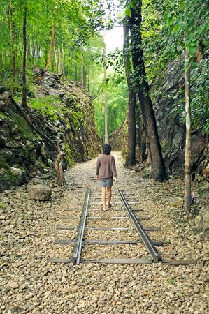 hellfire: Tourist walking throgh Hellfire pass (death railway) in Kanchanaburi, Thailand - built during World War II. Stock Photo