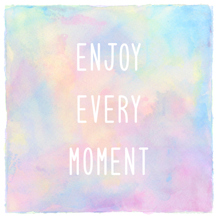 Enjoy every moment. Inspirational quote on pastel spray paint background.