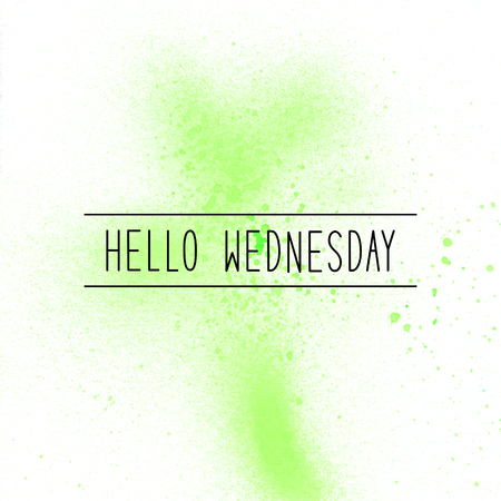 Hello Wednesday text on green spray paint background.