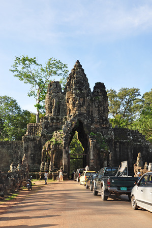 thom: SIEM REAP, CAMBODIA - AUGUST 10: Tourists visit South gate of Angkor Thom on August 10, 2014 in Siem Reap, Cambodia.