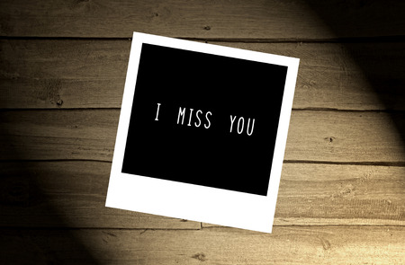 miss: I miss you note on brown wooden wall.