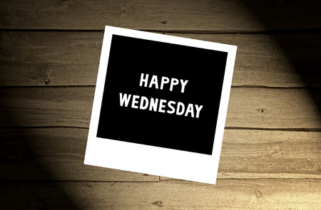 wednesday: Happy Wednesday note on brown wooden wall. Stock Photo