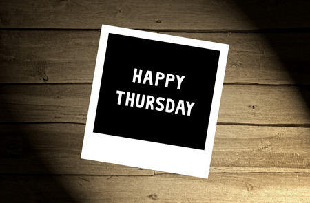 thursday: Happy Thursday note on brown wooden wall.