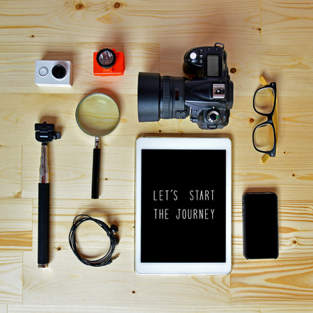 let s: Let s start the journey. Flat lay of accessories on wooden desk background of photographer, Voyage concept.