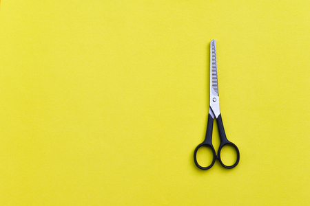 hairdressing scissors: Professional hairdressing scissors on yellow background.