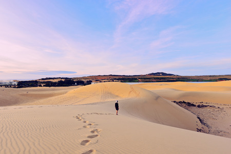 ne: Tourist in white sand dunes, Mui Ne, Vietnam.
