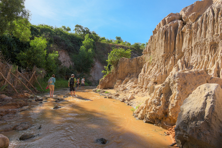 ne: MUI NE, VIETNAM - NOVEMBER 28, 2016: Unidentified tourists at Fairy Stream(Red river between rocks and jungle) on November 28, 2016 in Mui Ne, Vietnam.