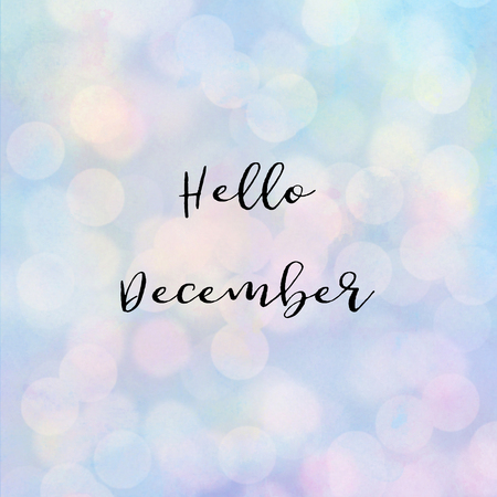 Hello December text with bokeh light on pastel background. Stock Photo