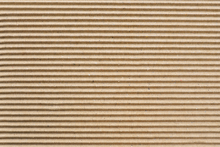 Brown corrugated cardboard useful as a background. Stock Photo