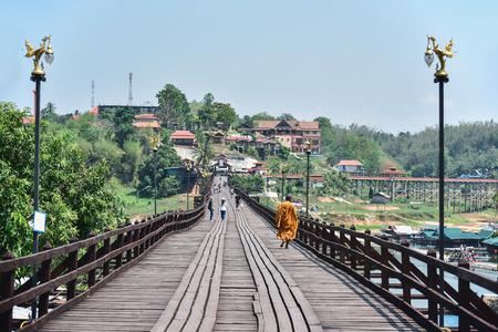 SANGKHLABURI-KANCHANABURI, THAILAND - MARCH 30 Tourists on old wooden bridge(Mon Bridge) in Sangkhlaburi District on March 30, 2015 in Sangkhlaburi, Kanchanaburi, Thailand. Editorial