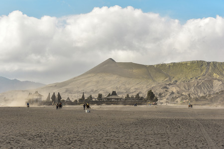 EAST JAVA, INDONESIA - OCT 19, 2015 : Unidentified horse riders for rent to Mount Bromo in East Java, Indonesia. Mt. Bromo is an active volcano and part of the Tengger massif, in East Java.