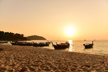 LIPE - SATUN, THAILAND - MARCH 01, 2016: Long tail wooden boats on the beach for tourists around Lipe island, Andaman sea in Satun, Thailand. Editorial