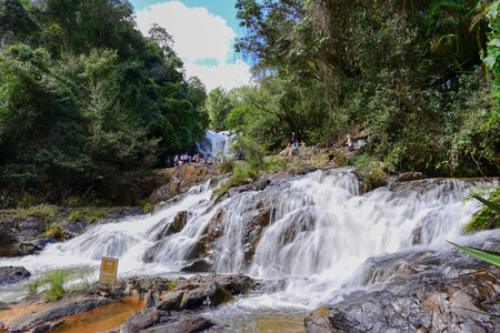 DALAT, VIETNAM - NOVEMBER 27, 2016: Unidentified tourists in Datanla waterfall. It is one of the more easily accessed falls in the vicinity of Dalat.