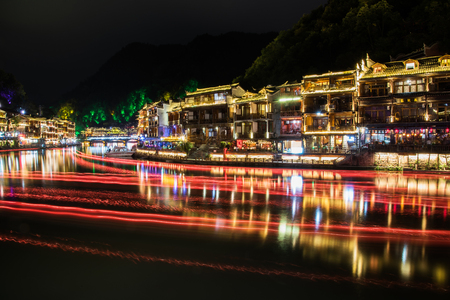 The Old Town of Phoenix (Fenghuang Ancient Town) at night, Hunan province, China.