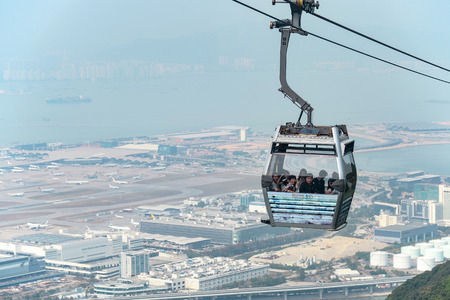 NGONG PING , HONG KONG - MARCH 30, 2018 : Unidentified people are on Ngong Ping 360 cable car with Chek Lap Kok airport. It is the popular public transportation from Tung Chung Station to Ngong Ping village.