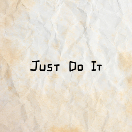 Just do it. Inspirational quote on old crumpled paper background.