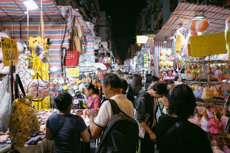 MING KOK, HONG KONG - MARCH 30, 2018 : Tourists shopping at lady market in Mong Kok, Hong Kong.