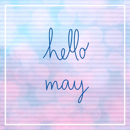 Hello May lettering with bokeh light on blue and pink corrugated paper. 免版税图像
