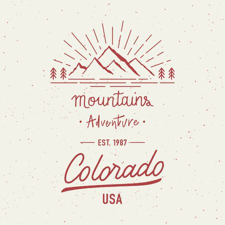 Mountain adventure and Colorado hand lettering with abstract watercolor splatters. Badge and label. Travel concept with mountains.