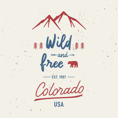 Wild and free with Colorado hand lettering. Travel concept with mountains and abstract watercolor splatters.