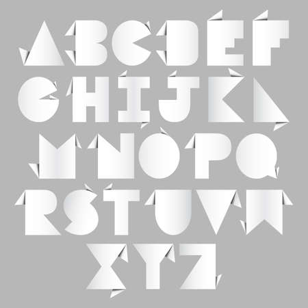 White origami alphabet letters on gray background.