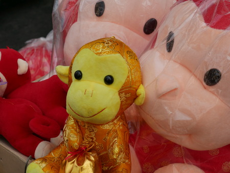 Monkey dolls sold on the sidewalk of China Town of Bangkok during the Chinese New Year. Banco de Imagens