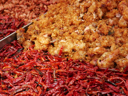 fried food: Deep-fried chicken and red chili, Street Food, Thailand Stock Photo