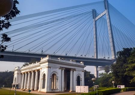 monument in india: James Prinsep Monument with Vidyasagar Setu Bridge in background, Kolkata, India