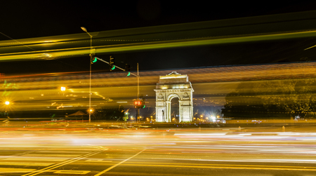 india gate: A wide angle long exposure shot of India Gate formerly known as the All India War Memorial with light trails of moving vehicles at Rajpath, New Delhi, India. Stock Photo