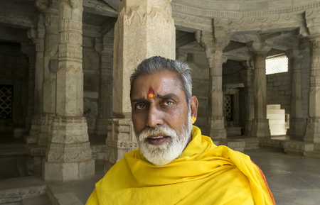Ranakpur, Rajasthan, India - June 18 2015: Portrait of high priest of Jain Temple, Ranakpur. Jainism is an Indian religion that emphasizes complete non-violence and asceticism. Jainism emerged in 6th-century BCE India, the same time Buddhism was developin